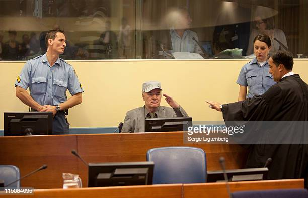 Former Bosnian Serb Military Leader Ratko Mladic salutes as he takes his seat in the International Criminal Tribunal where he faces war crime charges...