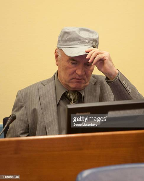 Former Bosnian Serb Military Leader Ratko Mladic takes his seat in the International Criminal Tribunal to face war crime charges on June 3 2011 in...