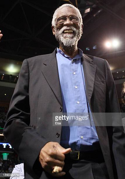 Former Boston Celtic Bill Russell waves to the cheering fans in the first quarter as the Boston Celtics take on the Detroit Pistons on February 15...