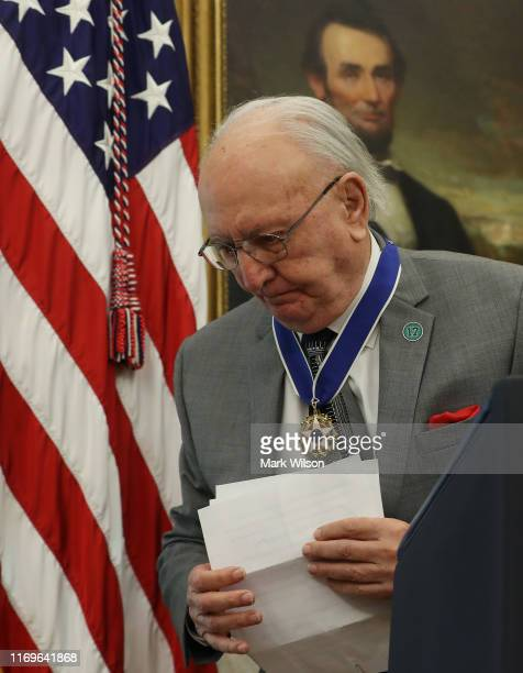 Former Boston Celtic Bob Cousy finishes reading a statement after US President Donald Trump presented him with the Medal of Freedom to in the Oval...