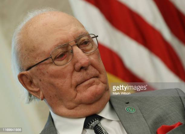 Former Boston Celtic Bob Cousy listens to US President Donald Trump introduce him before presenting him with the Medal of Freedom to in the Oval...