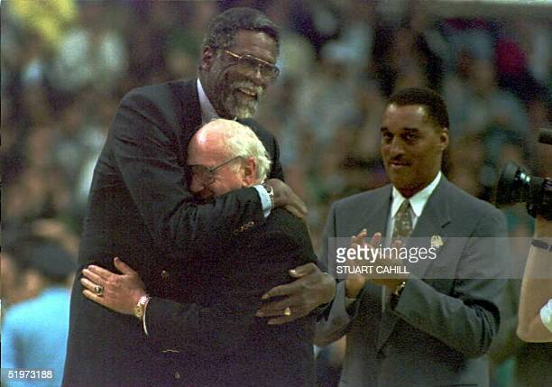 Former Boston Celtic great Bill Russell embraces his old coach and Celtic President Red Auerbach during half time activities commemorating the last...