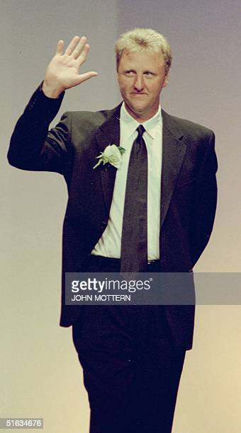 Former Boston Celtics and current Indiana Pacers head coach Larry Bird waves to an extended standing ovation during his induction ceremony to the...