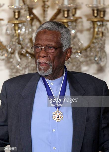 Former Boston Celtics captain Bill Russell is presented with the 2010 Medal of Freedom during an East Room event at the White House February 15 2011...
