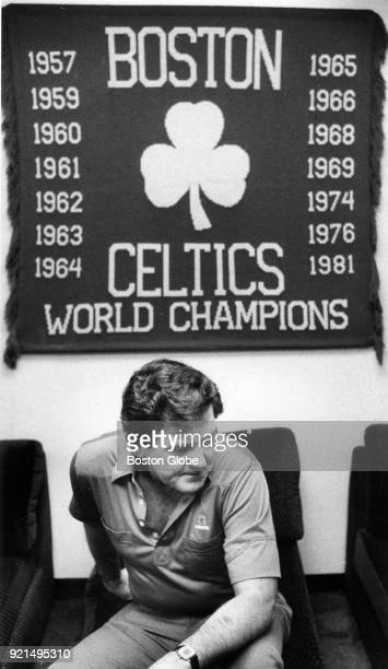 Former Boston Celtics coach Bill Fitch sits down after a press conference in which he announced his resignation from the team in Boston May 271983