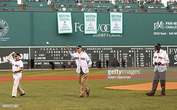 Former Boston Celtics General Manager Jan Volk and former Celtics players John Havlicek and Satch Sanders throw out the ceremonial first pitch on...