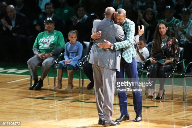 Former Boston Celtics player Paul Pierce hugs his former coach Doc Rivers during his number retirement ceremony after a game between the Boston...