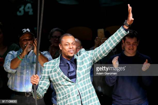 Former Boston Celtics player Paul Pierce raises a banner retiring his number during a ceremony in his honor after a game between the Boston Celtics...