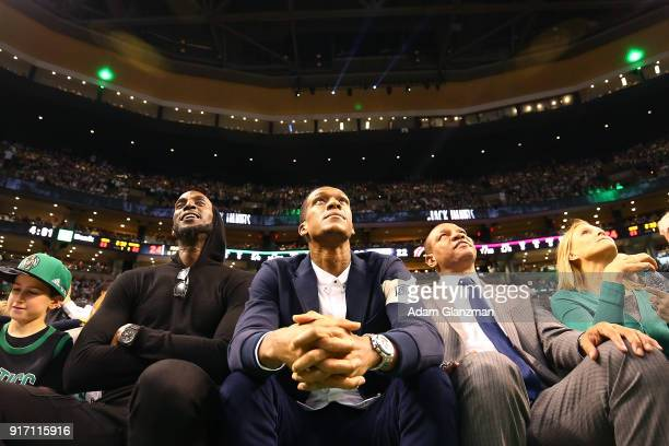Former Boston Celtics players Kevin Garnett Rajon Rondo and former coach Doc Rivers look on during a game between the Boston Celtics and the...