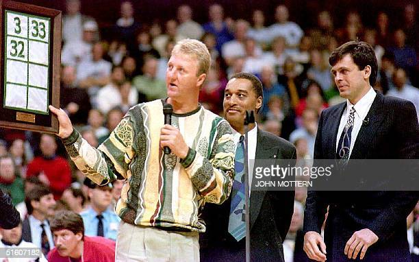 Former Boston Celtics players Larry Bird and Dennis Johnson present Kevin McHale a with a replica of the banner he later raised into the rafters of...