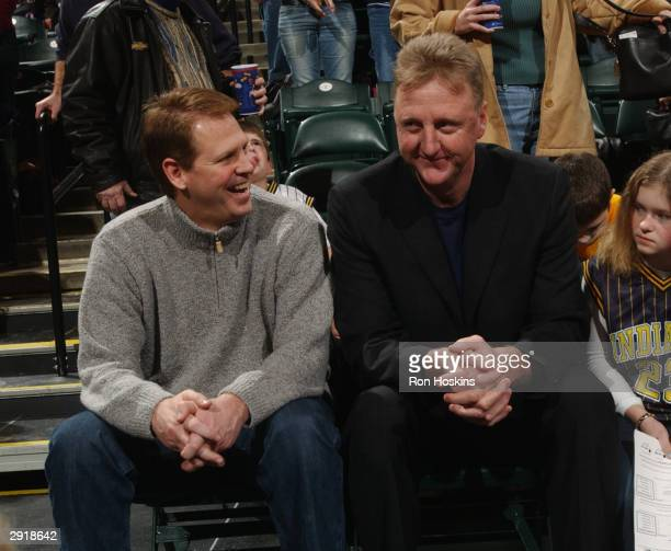 Former Boston Celtics teammates and now NBA team executives Danny Ainge, left, with the Celtics and Larry Bird with the Indiana Pacers chat during...