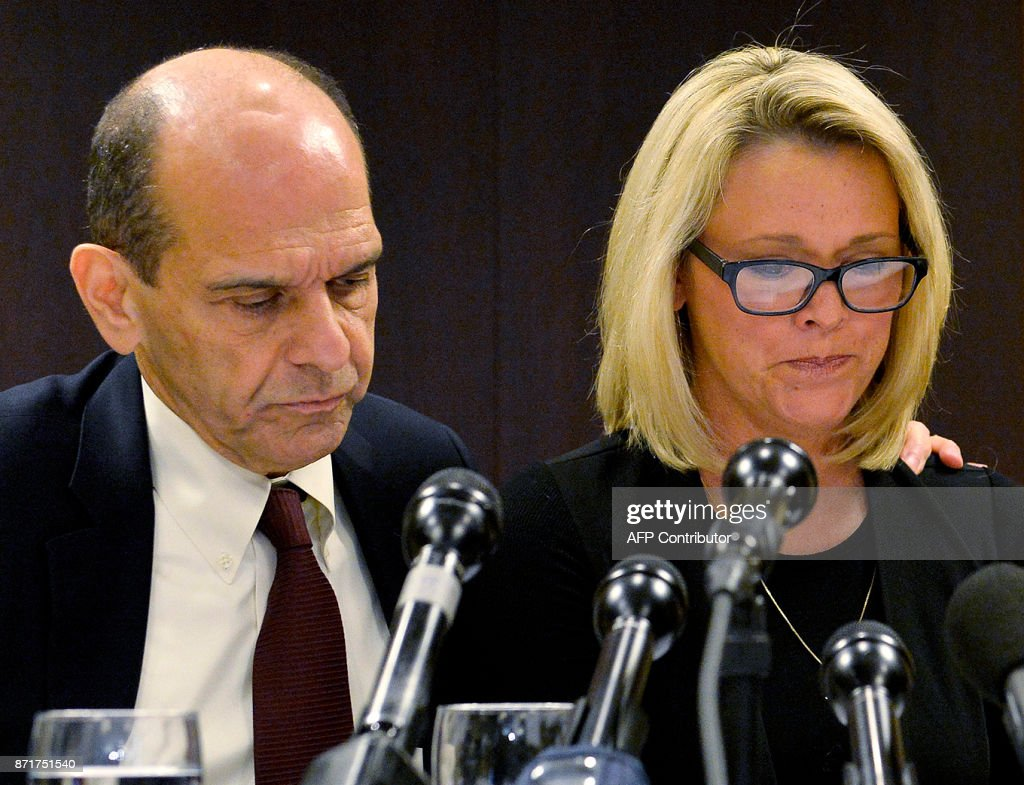 Former Boston news anchor Heather Unruh sits with her attorney