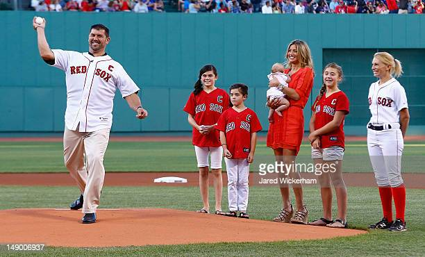 Former Boston Red Sox catcher and twotime World Series Champion Jason Varitek throws out the first pitch in front of his family after being honored...