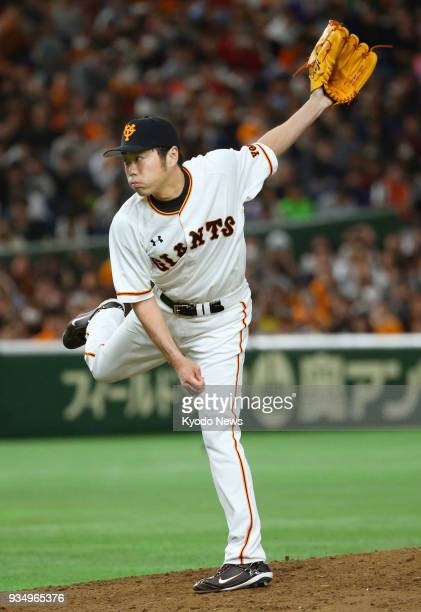 Former Boston Red Sox closer Koji Uehara pitches for the Yomiuri Giants in a preseason game against the Nippon Ham Fighters at Tokyo Dome on March 20...