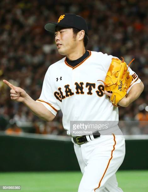 Former Boston Red Sox closer Koji Uehara returns to the dugout after pitching a scoreless seventh inning for the Yomiuri Giants in a preseason game...