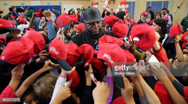 Former Boston Red Sox designated hitter David Ortiz autographs hats for students at the Hurley School in Boston on April 4 2018 Ortiz joined Mayor...