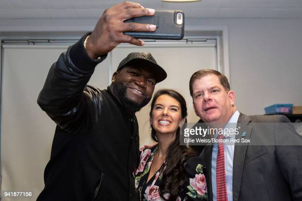 former Boston Red Sox designated hitter David Ortiz poses for a selfie photograph with Red Sox Foundation Board Member Linda Pizzuti Henry and Boston...