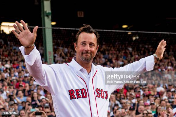 Former Boston Red Sox left pitcher Tim Wakefield is introduced during a ceremony for the retirement of the jersey number of David Ortiz before a game...