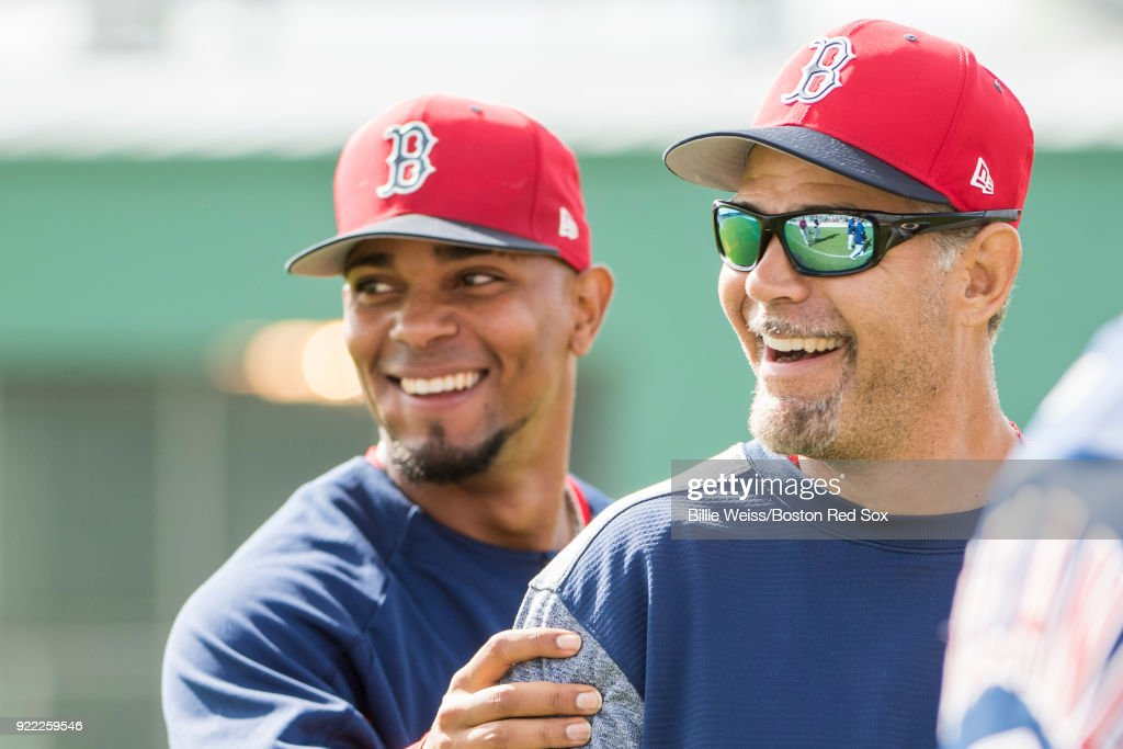 Former Boston Red Sox Mike Lowell reacts with Xander Bogaerts #2 during a team workout on February 21, 2018 at jetBlue Park at Fenway South in Fort Myers, Florida .
