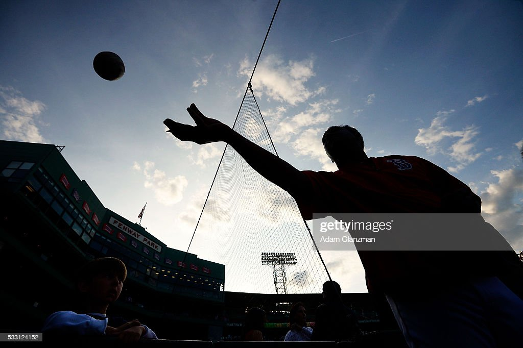 Former Boston Red Sox pitcher and Hall-of-Famer Pedro Martinez signs autographs before the game between the Boston Red Sox and the Cleveland Indians at Fenway Park on May 20, 2016 in Boston, Massachusetts.