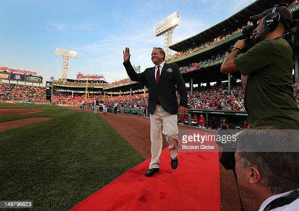 Former Boston Red Sox pitcher Curt Schilling walked the red carpet onto the field as one of the inductees to the Red Sox Hall Of Fame before the...