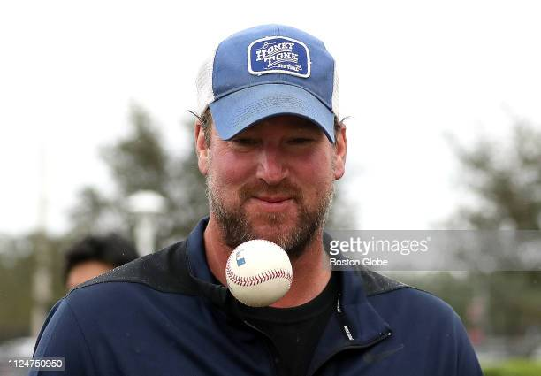 Former Boston Red Sox pitcher Derek Lowe makes an appearance during the first spring training workout of the year for Boston Red Sox pitchers and...