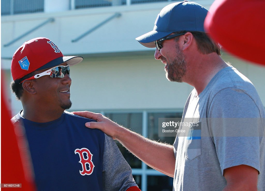 Former Boston Red Sox pitcher Derek Lowe, right, talks with former teammate Pedro Martinez during Red Sox spring training at the Player Development Complex at Jet Blue Park in Fort Myers, FL on Feb. 18, 2018.