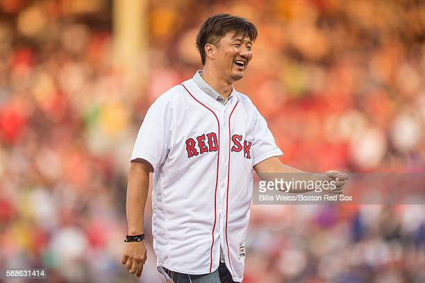 Former Boston Red Sox pitcher Hideki Okajima reacts after throwing out a ceremonial first pitch before a game against the New York Yankees on August...