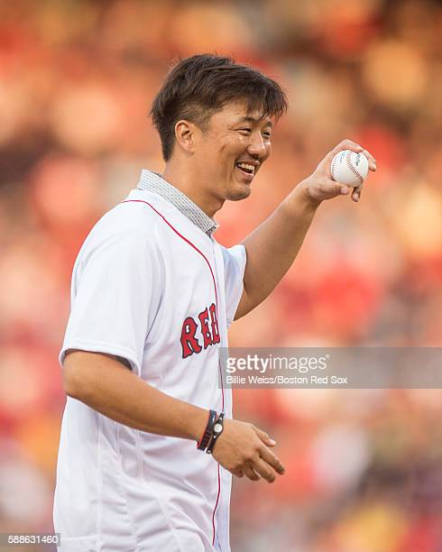 Former Boston Red Sox pitcher Hideki Okajima reacts before throwing out a ceremonial first pitch before a game against the New York Yankees on August...