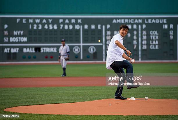 Former Boston Red Sox pitcher Hideki Okajima throws out a ceremonial first pitch on August 11 2016 at Fenway Park in Boston Massachusetts