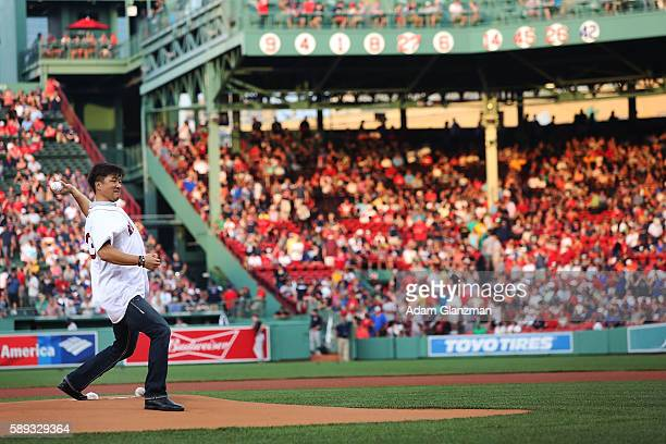 Former Boston Red Sox pitcher Hideki Okajima throws out a ceremonial first pitch before a game against the New York Yankees on August 11 2016 at...