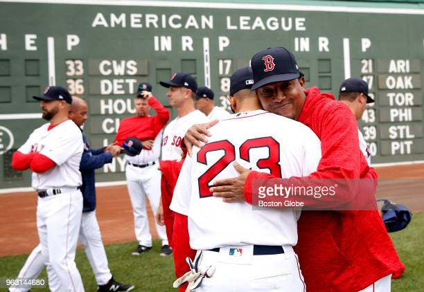 Former Boston Red Sox pitcher Pedro Martinez hugs Julio Lugo following the Red Sox alumni game at Fenway Park in Boston on May 27 2018