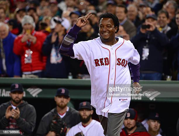 Former Boston Red Sox pitcher Pedro Martinez takes the field during a ceremony before the start of Game Two of the World Series against the Boston St...