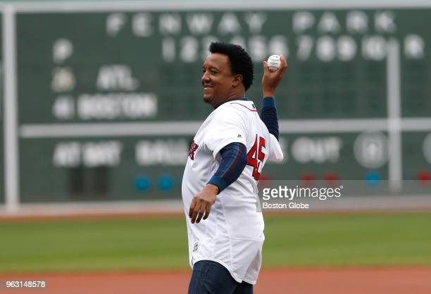 Former Boston Red Sox pitcher Pedro Martinez throws out the ceremonial first pitch before the start of a game between the Boston Red Sox and Atlanta...