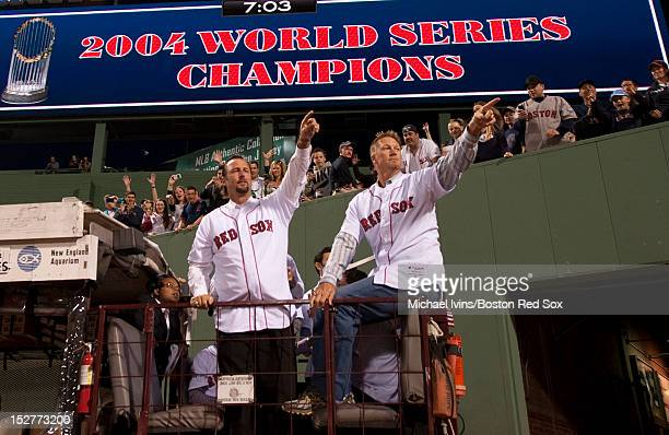Former Boston Red Sox pitchers Tim Wakefield and Mike Timlin enter Fenway Park on a duck boat during a ceremony honoring members of the 2004 team on...