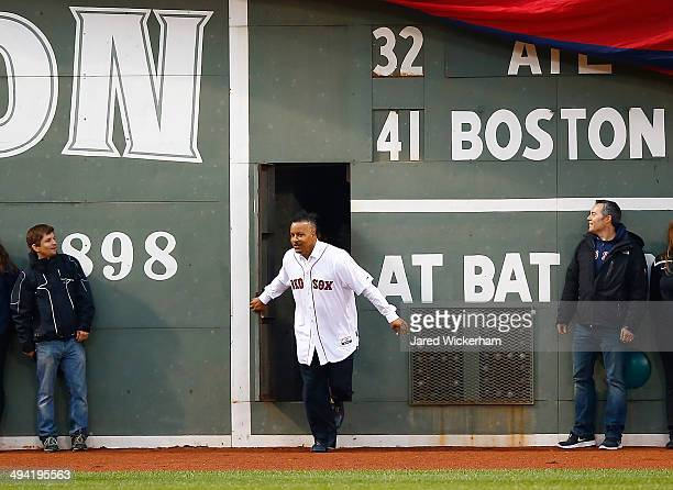 Former Boston Red Sox player and current player/coach for the Triple-A Iowa Cubs enters the field from the Green Monster door prior to the game...