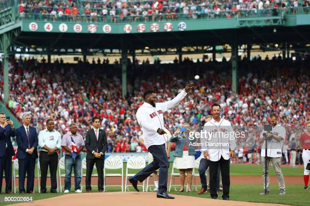Former Boston Red Sox player David Ortiz throws out a ceremonial first pitch during his jersey retirement ceremony before a game against the Los...