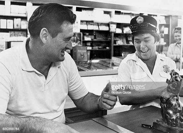 Former Boston Red Sox player Ted Williams left autographs his new book for meter maid Ruby Calman of Logan Way in South Boston at the Jordan Marsh...