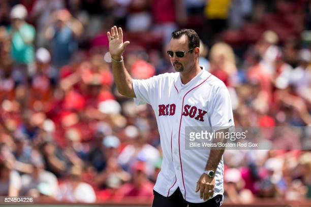 Former Boston Red Sox player Tim Wakefield is introduced during a 2007 World Series Champion team reunion before a game against the Kansas City...