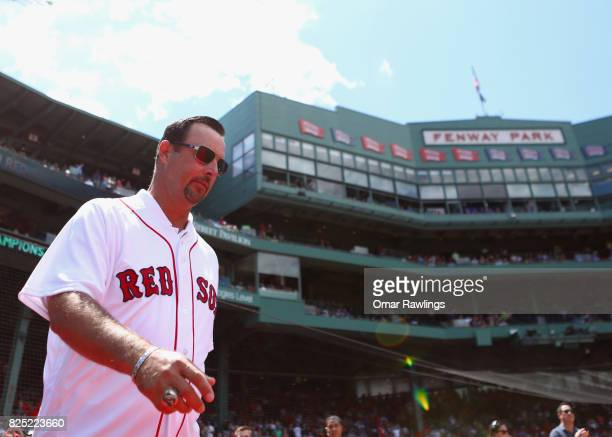 Former Boston Red Sox player Tim Wakefield is introduced during a 2007 World Series Championship team reunion before the game against the Kansas City...