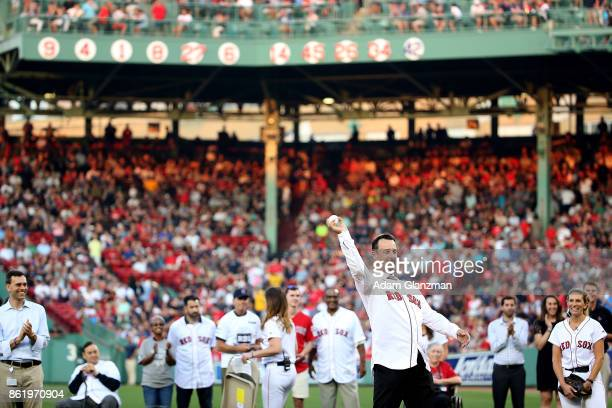 Former Boston Red Sox player Tim Wakefield throws out a ceremonial first pitch before a game against the New York Yankees at Fenway Park on August 19...