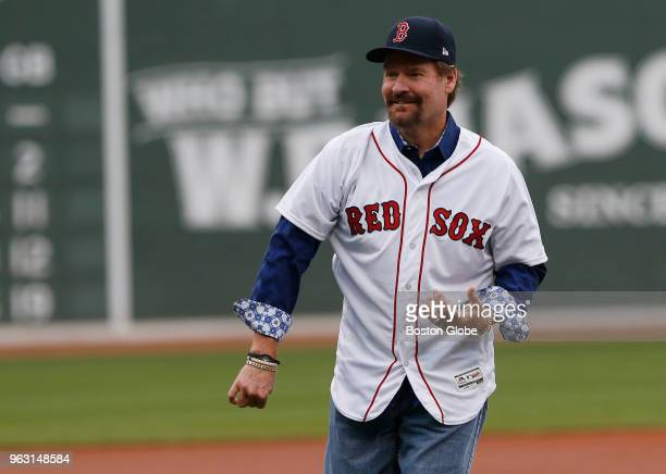 Former Boston Red Sox player Wade Boggs throws out the ceremonial first pitch before the start of a game between the Boston Red Sox and Atlanta...