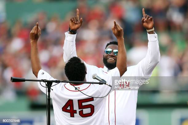 Former Boston Red Sox players David Ortiz and Pedro Martinez react during the David Ortiz jersey retirement ceremony before a game against the Los...