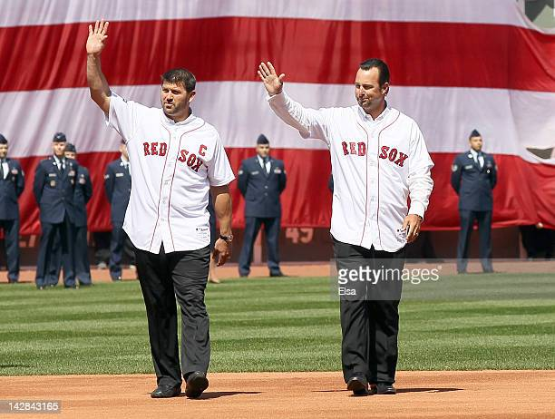 Former Boston Red Sox players Jason Varitek and Tim Wakefield throw out the ceremonial first pitch before the home opener between the Boston Red Sox...