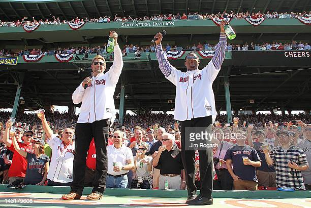 Former Boston Red Sox players Kevin Millar and Pedro Martinez lead a toast during 100 Years of Fenway Park ceremony before a game between the Boston...
