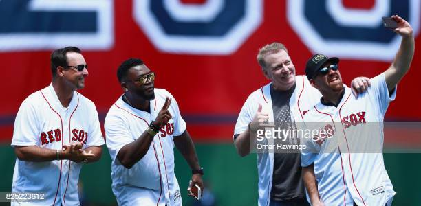 Former Boston Red Sox players Tim Wakefield David Ortiz Curt Schilling and Kevin Youkilis take a selfie during a 2007 World Series Championship team...