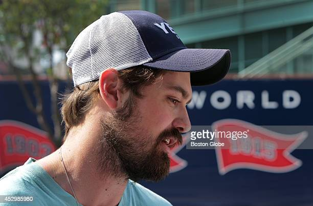 Former Boston Red Sox relief pitcher Andrew Miller talks with the media outside Fenway Park. Miller stopped by Fenway to pick up his gear after being...