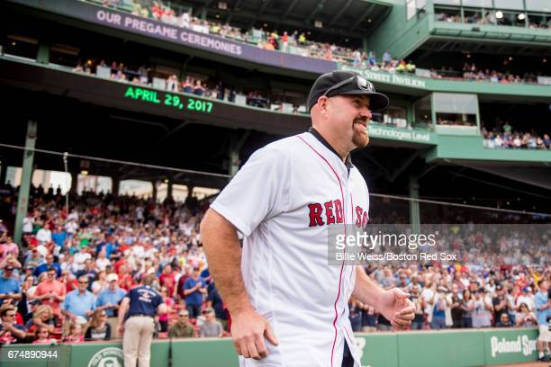 Former Boston Red Sox third baseman Kevin Youkilis is introduced before throwing out the ceremonial first pitch before a game against the Chicago...