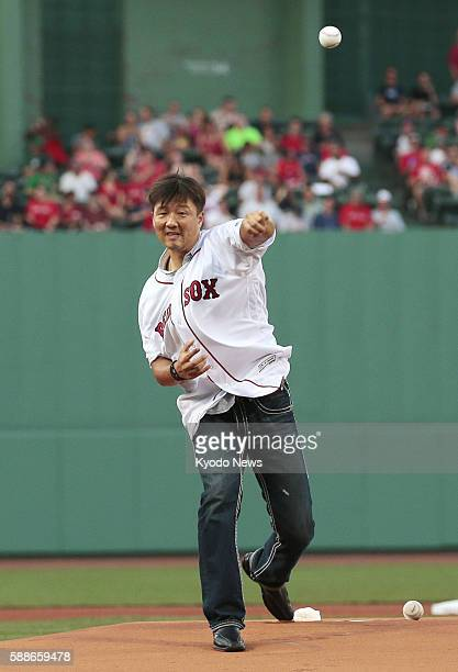 Former Boston reliever Hideki Okajima throws out the ceremonial first pitch before a game between the Red Sox and New York Yankees at Fenway Park on...