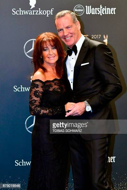 Former boxer Henry Maske and his wife Manuela pose on the red carpet upon their arrival for the 2017 BAMBI awards ceremony on November 16, 2017 at...